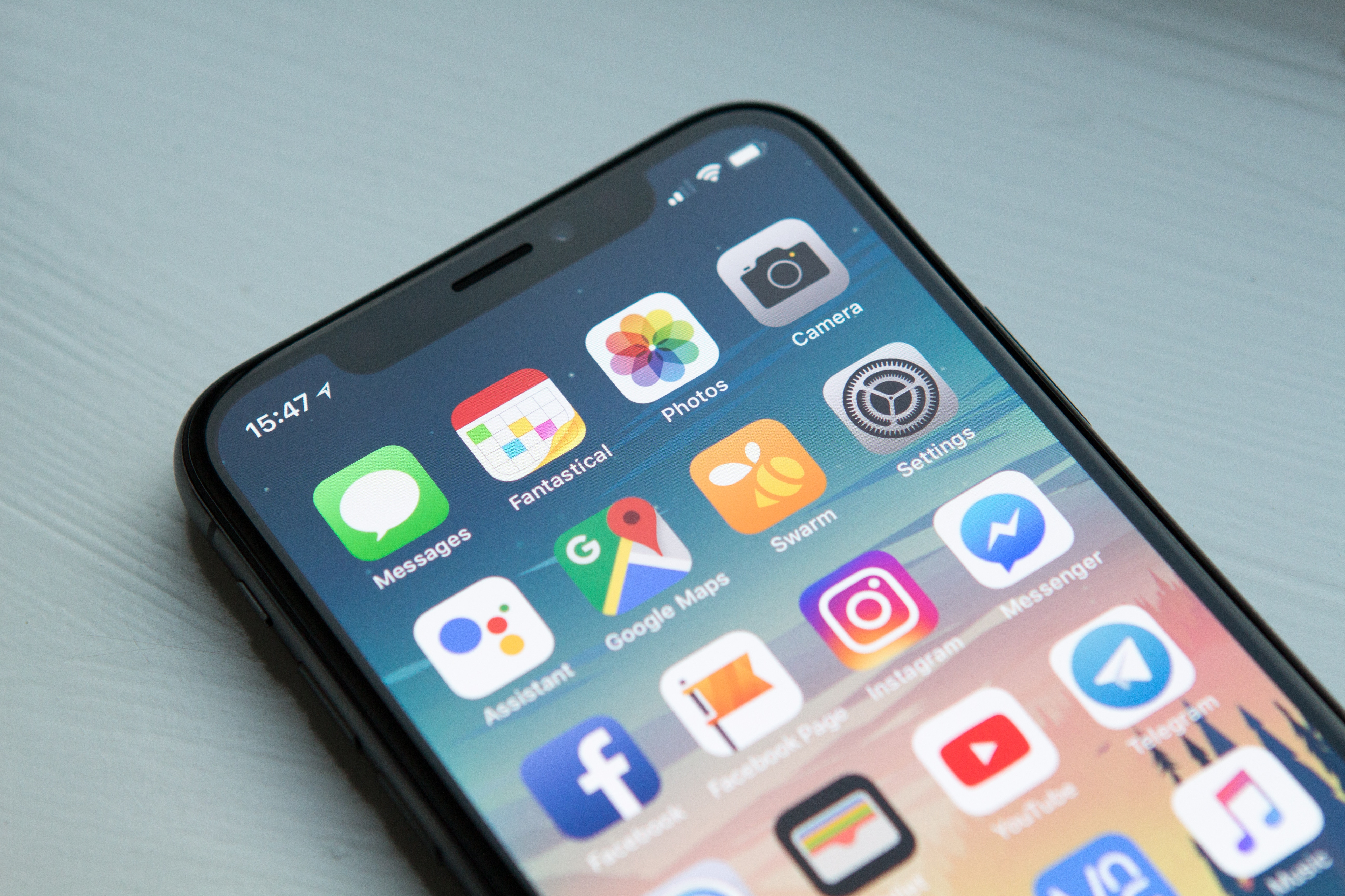 iPhone X with apps on the main screen