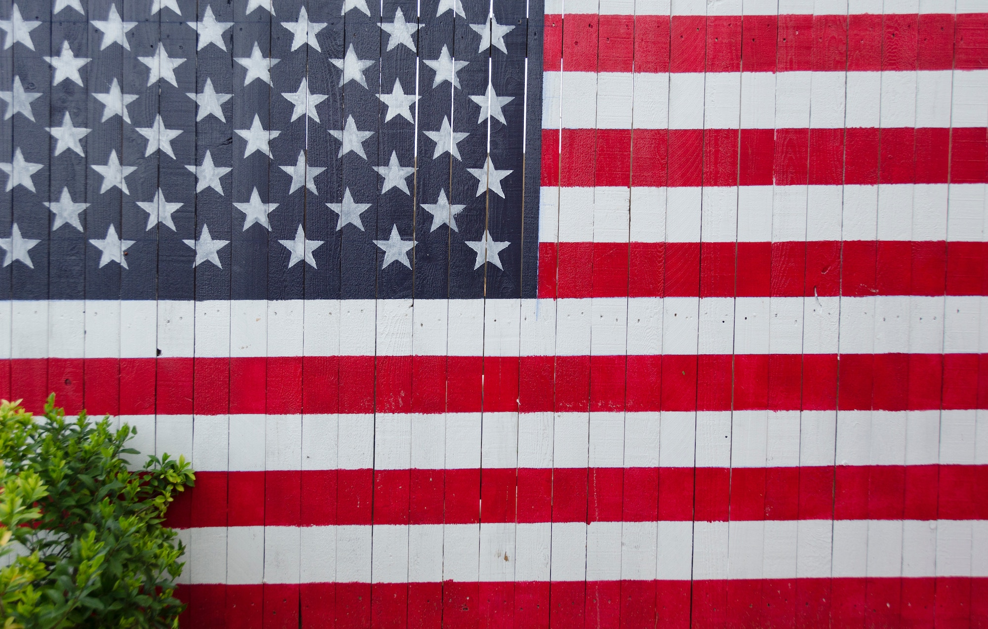 american flag painted on an old fence